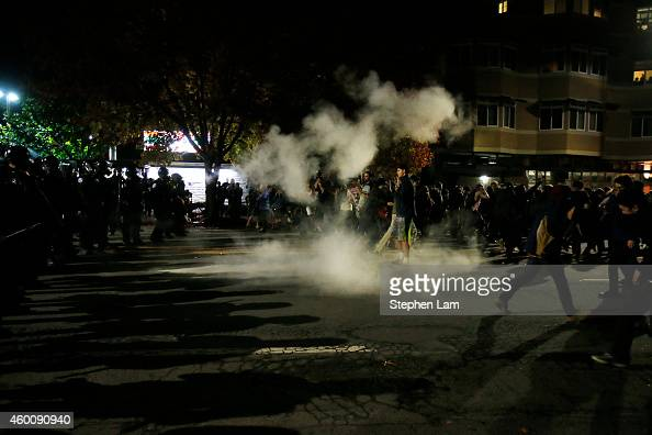 Demonstrators retreat after the police deploy gear gas during a demonstration over recent grand jury decisions in policeinvolved deaths on December 7...