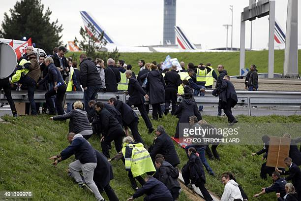 Demonstrators runs away during a demonstration in front of the Air France headquarters in RoissyenFrance on October 5 2015 Air FranceKLM unveiled a...