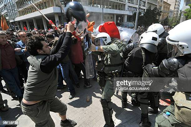 Demonstrators scuffle with riot police during a demonstration in central Athens on April 22 2010 Greek civil servants today staged the fourth 24hour...