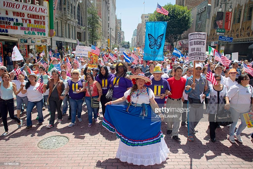 Demonstrators seeking change in immigration policy march on May Day in Los Angeles, California, May 01, 2013. Some 2,000 demonstrators marched in May Day rallies calling for immigration reform, a key issue just north of the US-Mexican border.