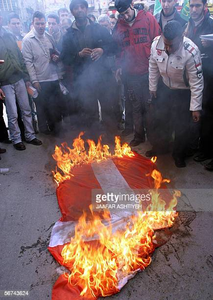 Demonstrators set a Danish flag ablaze as they protest against the countries that have published cartoons depicting Prophet Mohammad 04 February 2006...