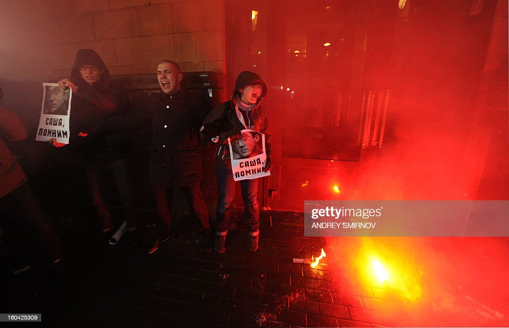 Demonstrators shout and burn flares in central Moscow on January 31, 2013, during traditional unauthorized protest rally of opposition activists to defend Article 31 of the Russian constitution which guarantees freedom of assembly. Russian opposition activists calling on authorities to respect the right to assembly organize rallies every 31st of a month, which often leads to arrests by police.