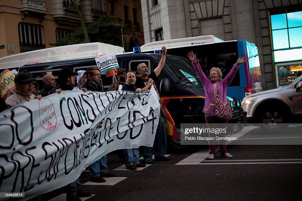 Demonstrators shout slogans and hold a banner during a protest against spending cuts and the government of Mariano Rajoy on October 27, 2012 in Madrid, Spain. Banner reads 'Banksters go home'. Demonstrators are protesting near the Spanish Parliament against the government's austerity measures. With the economic crisis tightening it's grip, Spain is in its second recession in three years, Rajoy's governement is presssured more and more to seek aid that can ease their debts.