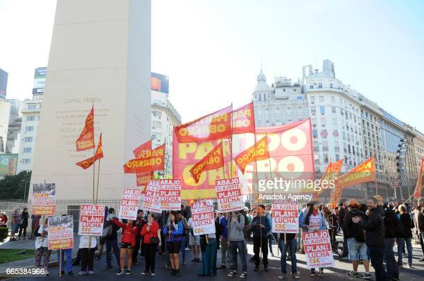 Demonstrators shout slogans and hold banners in the city street on this morning during the national CGT strike and the CTA against the economic...