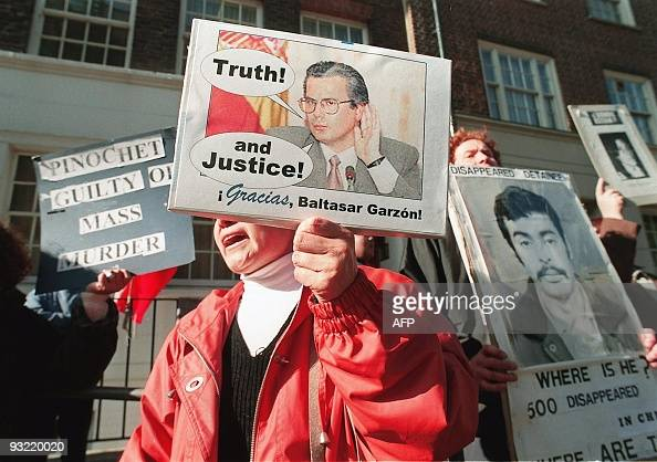 Demonstrators shout slogans and hold placards 1 8 October at the entrance to The London Clinic hospital where former dictator Augusto Pinochet is...