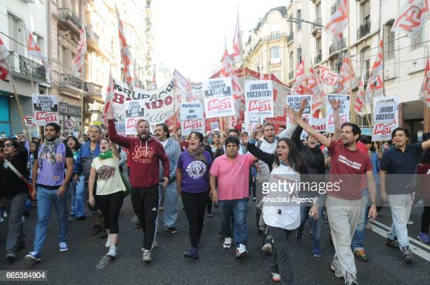 Demonstrators shout slogans and march through the city streets on this morning during the national CGT strike and the CTA against the economic...