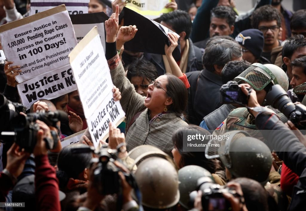 Demonstrators shout slogans as Policemen are trying to stop them from approaching a barricade on their way to India Gate while protesting against a recent gang-rape on December 27, 2012 in New Delhi, India. Indian Prime Minister Manmohan Singh pledged Thursday to take action to protect the nation's women while the young rape victim was flown to Singapore for treatment of severe internal injuries.