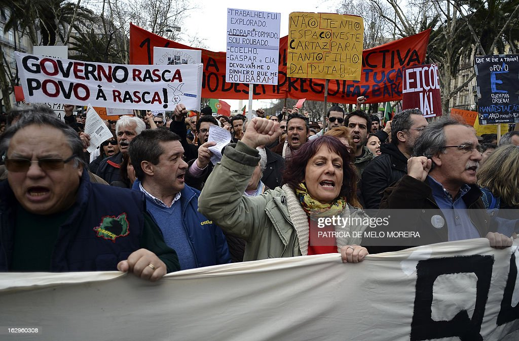 Demonstrators shout slogans as they take part in a demonstration in downtown Lisbon on March 2, 2013. Several thousnads of people demonstrate today in the Portuguese capital to protest against government austerity measures.