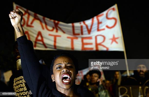 Demonstrators shout slogans during a march in St Louis Missouri on November 23 2014 to protest the death of 18yearold Michael Brown More than 100...