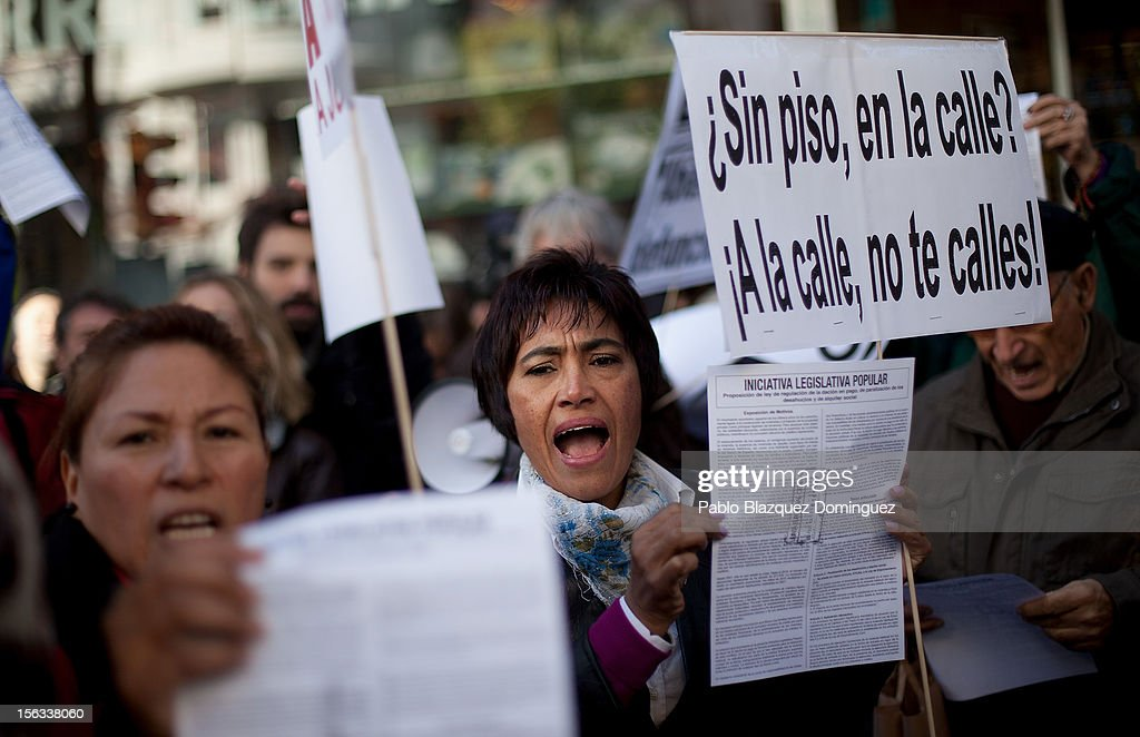 Demonstrators shout slogans during a protest against evictions outside the PP (Popular Party) headquarters on November 12, 2012 in Madrid, Spain. Placard reads 'Without home, in the street? At the street, do not be silent'. Spain's banks announced today that for the next two years they will suspend mortgage-related evictions of the most vulnerable people. The Spanish Banking Association (AEB) reacted three days after a woman in Barakaldo took her life just before she was due to be evicted from her home. A male homeowner facing eviction in Grenada committed suicide fifteen days earlier. There have been around 350,000 house evictions since Spain's property market crashed in 2008. The Platform for Mortgage Victims organisation has been preventing some evictions by blocking access to houses under threat of repossession.