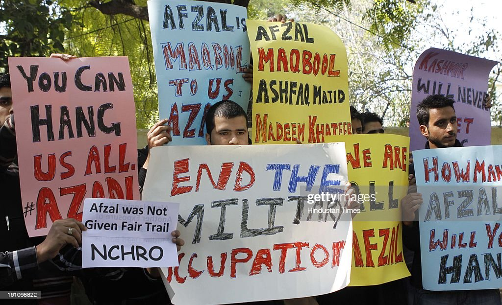Demonstrators shout slogans during a protest to condemn the hanging of Mohammad Afzal Guru on February 9, 2013 in New Delhi, India. Guru, who was found guilty of conspiring and sheltering the militants who attacked Parliament on December 13, 2001 in which nine people were killed, was buried in the prison premises as per the jail manual.