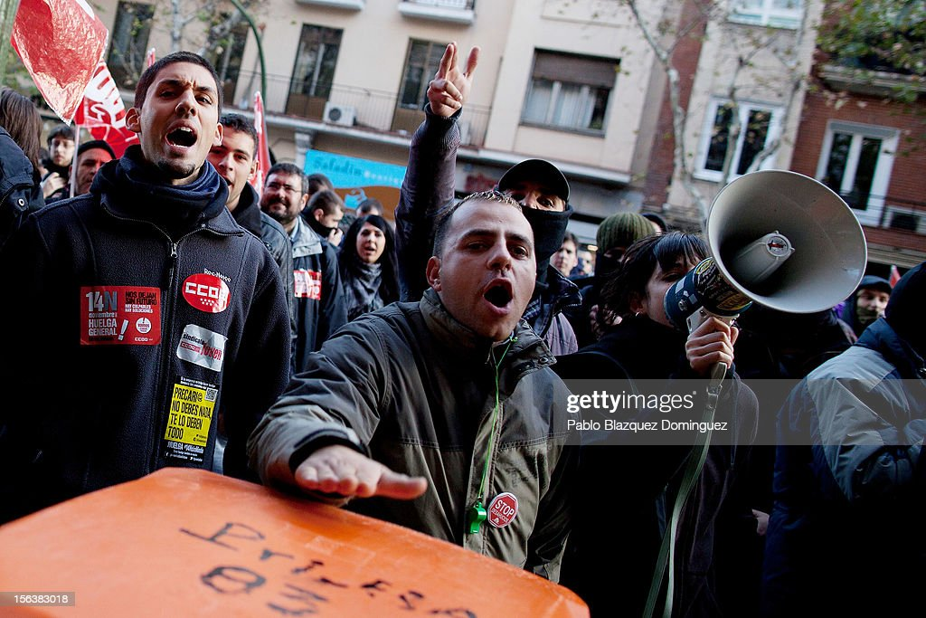 Demonstrators shout slogans to people in a restaurant in Gran Via on November 14, 2012 in Madrid, Spain. A coordinated general strike by unions in Spain and Portugal has paralysed public transport in the two countries with further strikes planned across Europe. The strike against the governments' austerity measures have force hundreds of flights to be cancelled and factories and ports to come to a standstill.