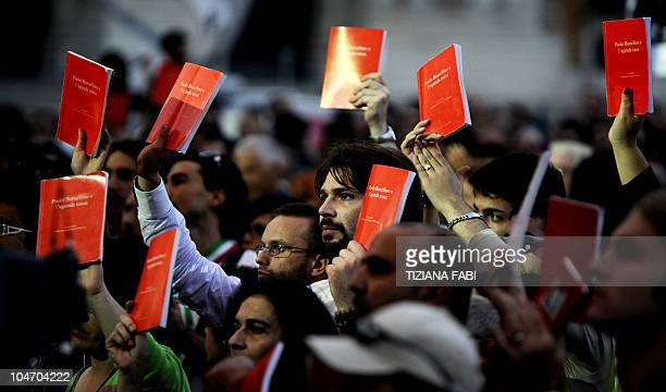 Demonstrators show the book of murdered antiMafia judge Paolo Borsellino as they march during a 'No Berlusconi day' protest in Rome on October 2 2010...
