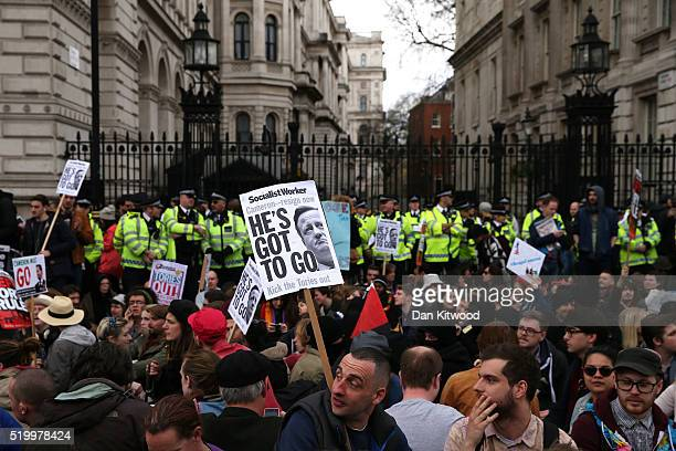 Demonstrators sit down in protest outside Downing Street on Whitehall on April 9 2016 in London England Inside the Conservative party were holding...
