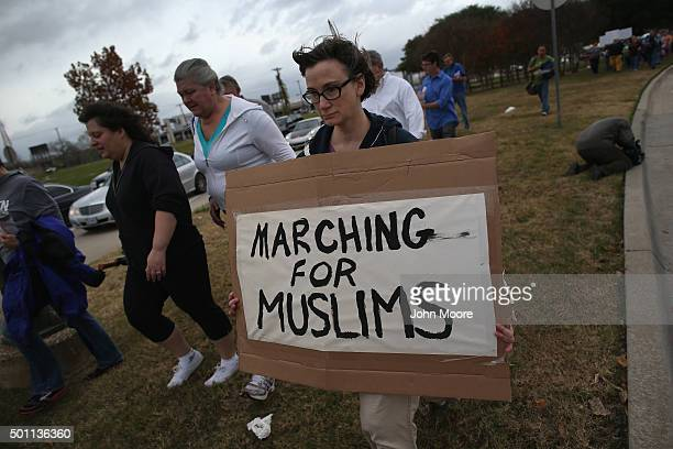 Demonstrators stage a peace march against ''Islamophobia'' on December 12 2015 in Dallas Texas The Dallas area had become a focal point for...