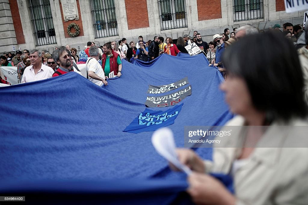 Demonstrators stage a protest against the Government's austerity measures applied due to the Spanish economic crisis that began in 2008, at Puerta del Sol, Madrid, Spain on May 28, 2016.