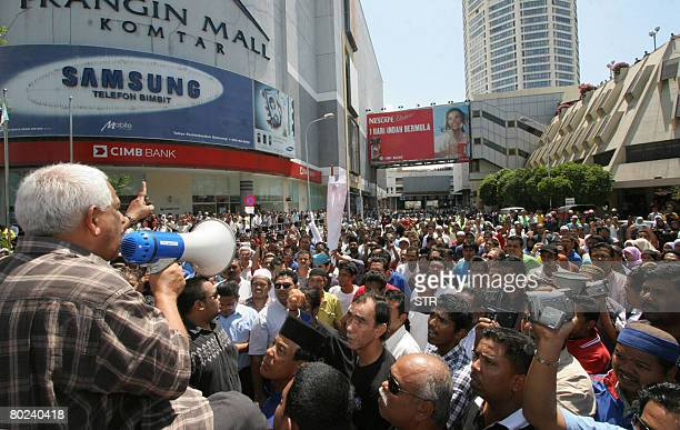 Demonstrators supporting the ruling United Malays National Organisation the largest component party of the Barisan Nasional coalition take to the...