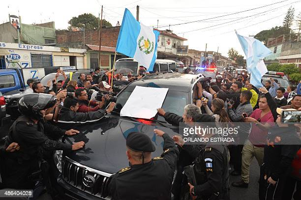 Demonstrators surround the vehicle carrying former Guatemalan President Otto Perez upon arrival at the Matamoros military barracks in Guatemala City...