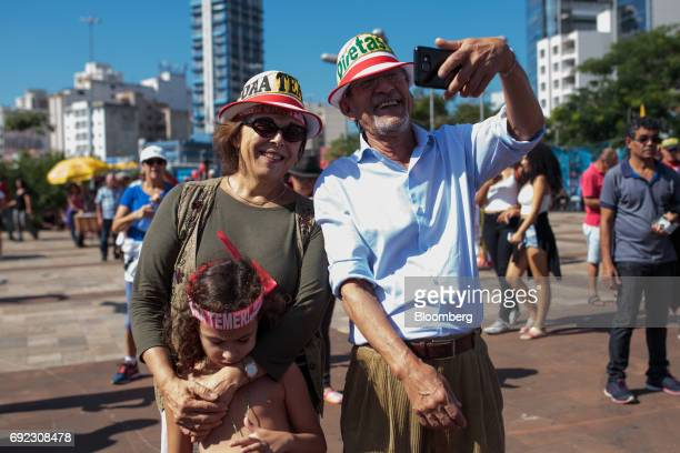 Demonstrators take a selfie photograph during a protest against Brazilian President Michel Temer and government corruption at Largo da Batata in Sao...