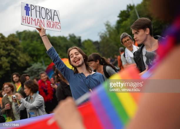 Demonstrators take part in a Gay Pride demonstration on June 8 2013 in Bucharest Some 400 people took to the streets of Bucharest for a Gay Pride...