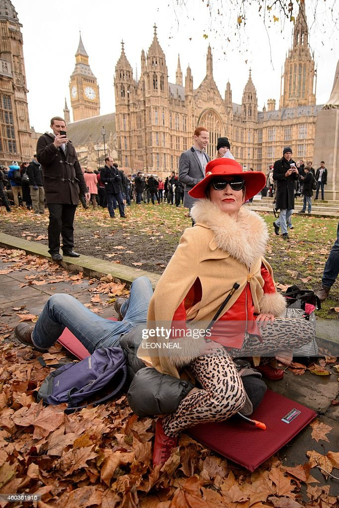 Demonstrators take part in a mass 'face-sitting protest' outside ...
