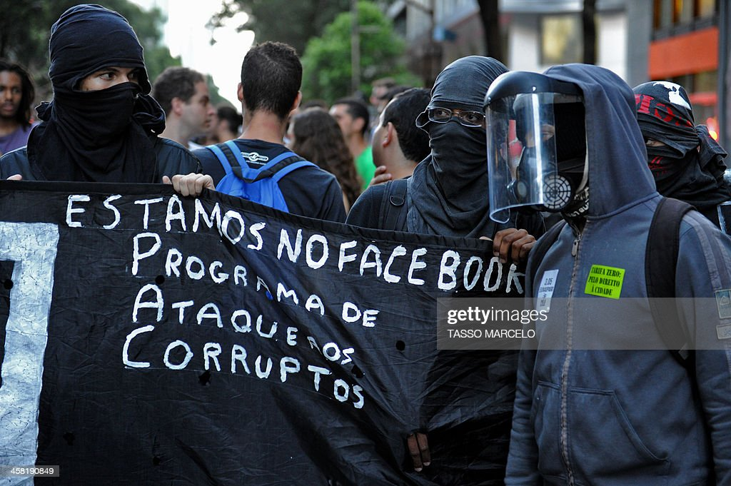 Demonstrators take part in a protest against a public transport fare hike announced for January 2014 by Rio de Janeiro's Mayor Eduardo Paes, in the streets of the Brazilian city, on December 20, 2013. The banner reads 'We Are in Facebook: Programme of Attacks Against the Corrupt'.