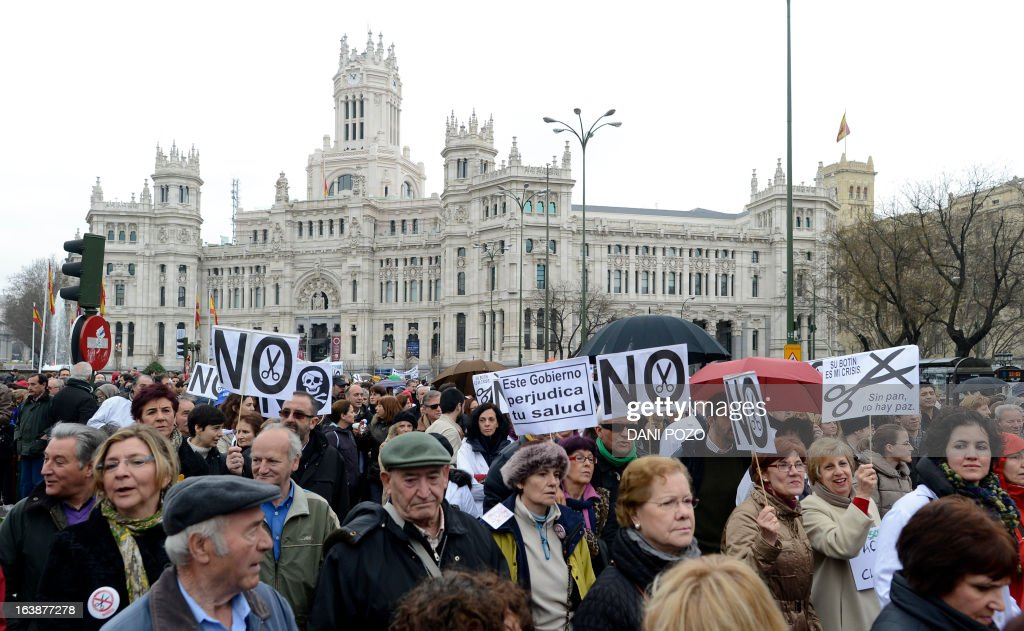 Demonstrators take part in a protest against government's austerity measures and health care spending cuts in Madrid on March 17, 2013.