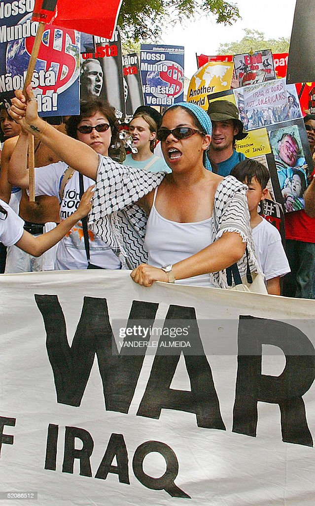 Demonstrators take part in a protest against President George W Bush Iraq's war and the Free Trade Area of the Americas during the closing day of the...