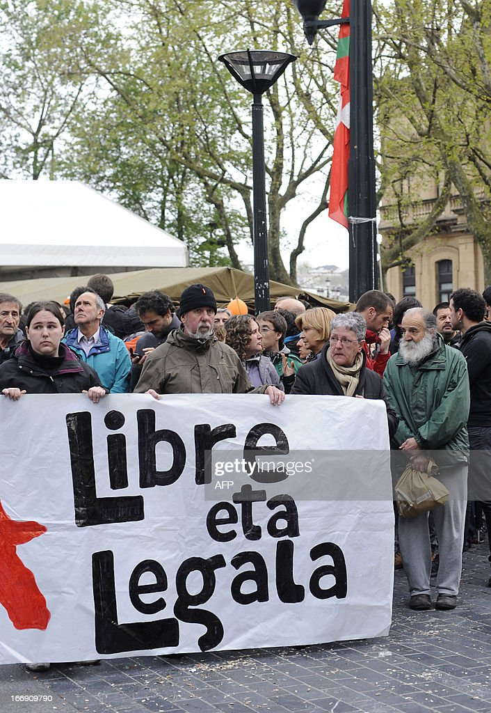 Demonstrators take part in a protest against the incarceration of eight members of Basque pro-independence youth organization SEGI in the northern Spanish Basque city of San Sebastian on April 18, 2013. Hundreds of people remain gathered in San Sebastian, to prevent the incarceration of eight members of SEGI sentenced to six years in prison by the Supreme Court. The Spanish Court issued arrest warrants on April 16 against Mikel Arretxe, Imanol Vicente, Naikari Otaegi, Egoi Alberdi, Aitor Olaizola, Adur Fernandez, Oier Lorente y Ekaitz Ezkerra for membership in an organized armed group.