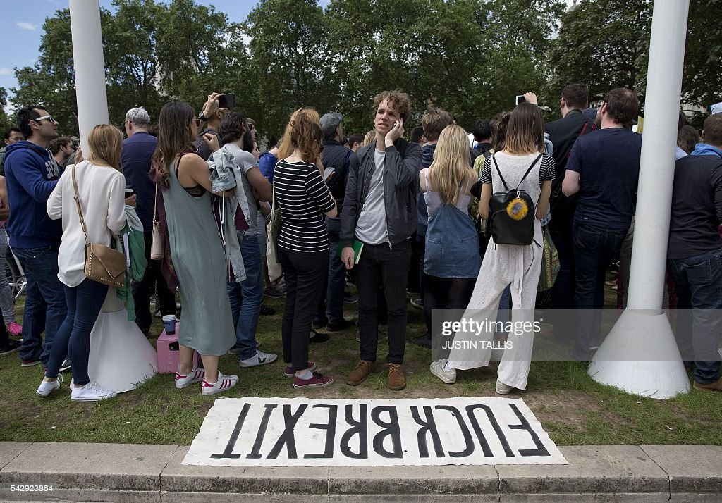 Demonstrators take part in a protest against the pro-Brexit outcome of the UK's June 23 referendum on the European Union (EU), in central London on June 25, 2016. The result of Britain's June 23 referendum vote to leave the European Union (EU) has pitted parents against children, cities against rural areas, north against south and university graduates against those with fewer qualifications. London, Scotland and Northern Ireland voted to remain in the EU but Wales and large swathes of England, particularly former industrial hubs in the north with many disaffected workers, backed a Brexit. / AFP / JUSTIN