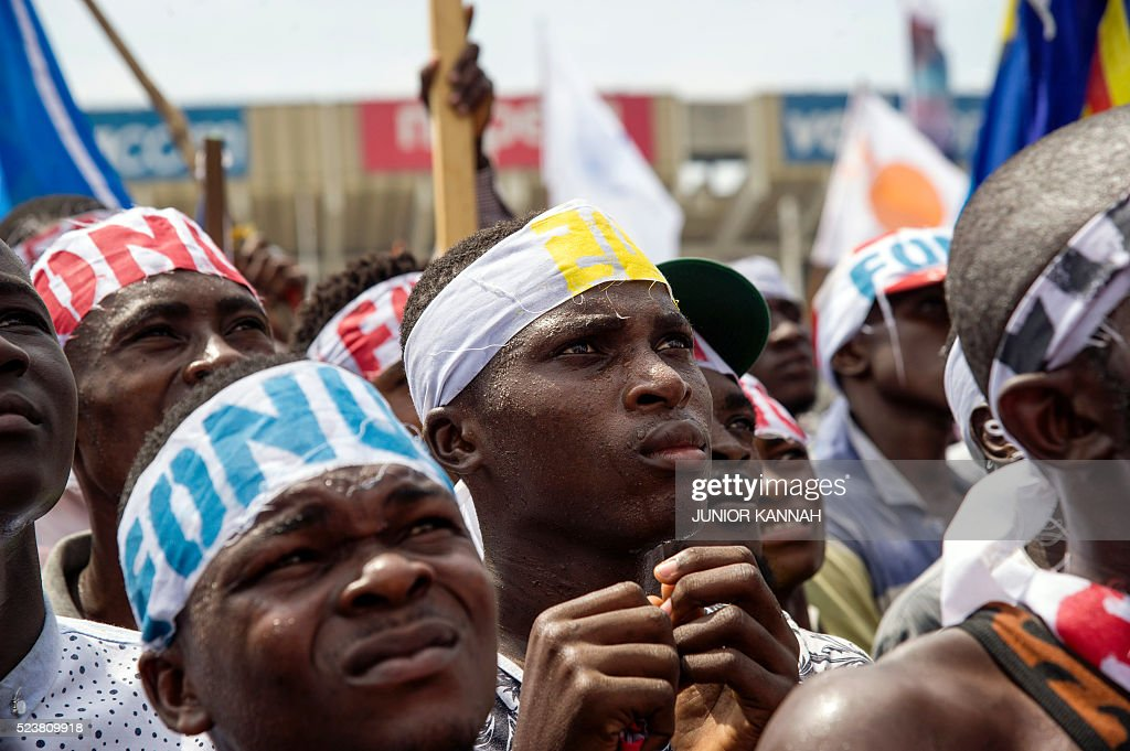 Demonstrators take part in a protest calling for elections, in Kasa-Vubu on April 24, 2016. The DRC is supposed to hold elections in November, but the chances of them actually taking place are growing dimmer, with President Joseph Kabila suspected of planning to extend his rule after his mandate runs out at the end of the year. / AFP / JUNIOR