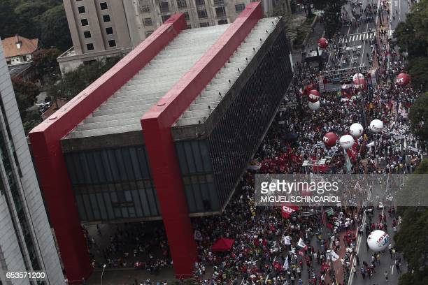 Demonstrators take part in a protest during a national strike against the government's social welfare reform bill which seeks to extend the time of...