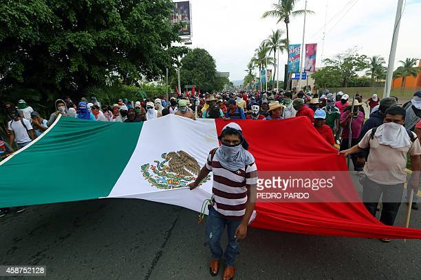 Demonstrators take part in a protest followed by clashes against the suspected massacre of 43 missing students near the airport in Acapulco in the...