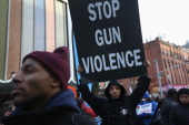 Demonstrators take part in a rally against gun violence on March 21 2013 in the Harlem neighborhood of the Manhattan borough of New York City The...