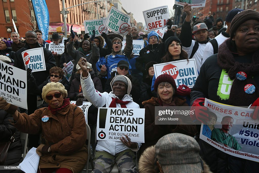 Demonstrators take part in a rally against gun violence on March 21, 2013 in the Harlem neighborhood of the Manhattan borough of New York City. The group Moms Demand Action for Gun Sense In America as well as gun violence victims, youth organizations, healthcare workers, unions, elected officials, faith leaders and artists demonstrated to promote New York Gov. Andrew Cuomo's NY SAFE Act as a national model for federal gun control legislation.