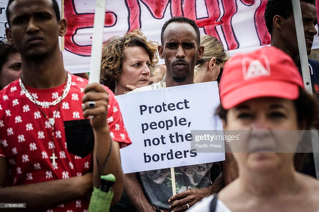 Demonstrators take part in a rally to show solidarity for the hundreds of migrants died over the past months in their attempts to cross the...