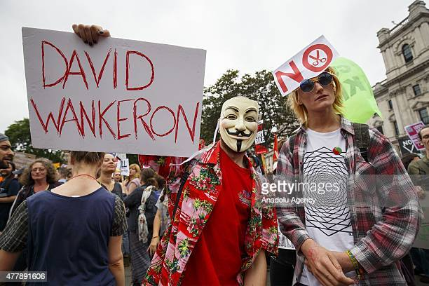 Demonstrators take part in an 'End Austerity Now' protest against austerity and spending cuts in London England on June 20 2015 Activists are...