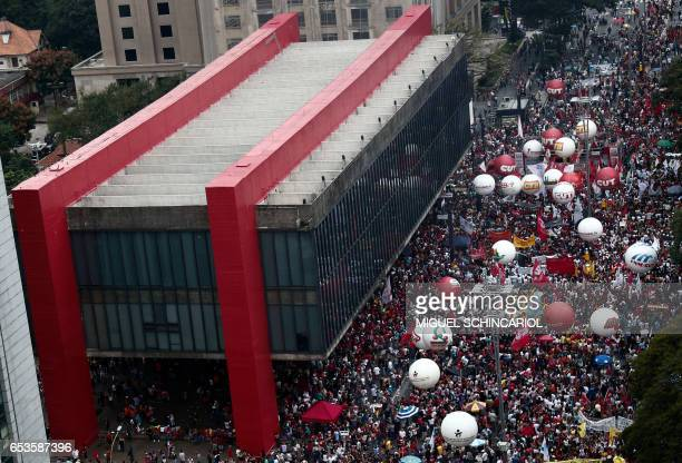 Demonstrators take part of a protest during a national strike against the government's social welfare reform bill which seeks to extend the time of...