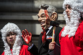 Demonstrators talk on a podium outside the Queen Elizabeth II conference centre on July 6 2016 in London England The Iraq Inquiry Report into the UK...