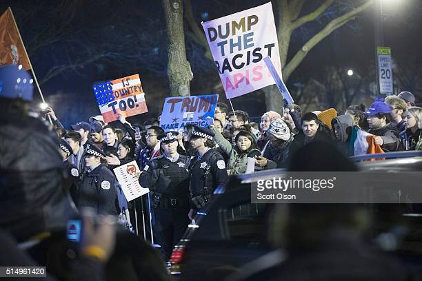 Demonstrators taunt supporters of Republican presidential candidate Donald Trump as they leave a rally at the University of Illinois at Chicago which...