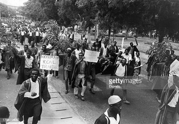 Demonstrators throng the streets of Accra capital of Ghana bearing banners that proclaim ' Nkrumah Real Traitor' in 3/2/1966