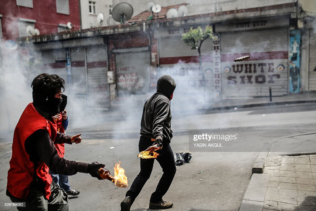 Demonstrators throw molotov cocktails during a May Day rally in the Okmeydani neighbourhood of Istanbul on May 1, 2016. Turkish police clamped down on unauthorised protests during a tense May Day in Istanbul, using tear gas and water cannon against demonstrators and imposing a heavy security blanket on the city. / AFP / YASIN