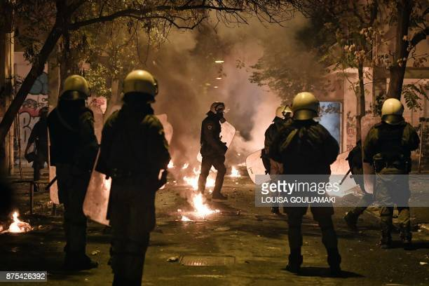 TOPSHOT Demonstrators throw molotov cocktails during clashes with police on November 17 2017 in Athens following a rally commemorating the 1973...