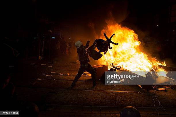 Demonstrators throw office furniture from a destroyed bank into a bonfire on February 25 2014 Thousands marched against corruption following the...