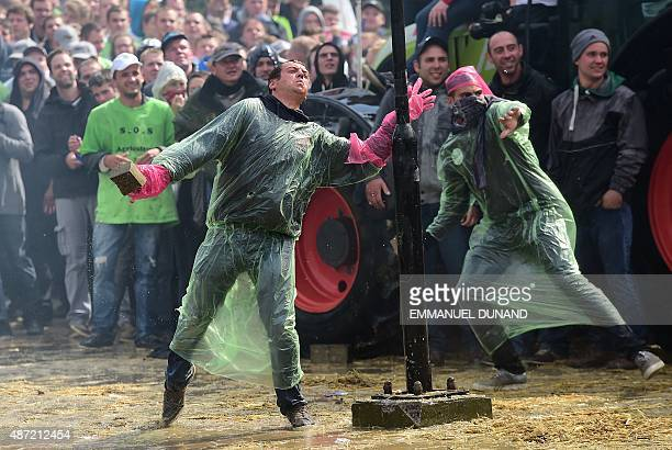 Demonstrators throw rocks on antiriot policemen during a demonstration of farmers in front of the European Commission building on September 7 in...