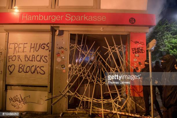 Demonstrators try to destroy the entrance of a bank during a demonstration against the G20 Summit on July 7 2017 in Hamburg Germany Leaders of the...