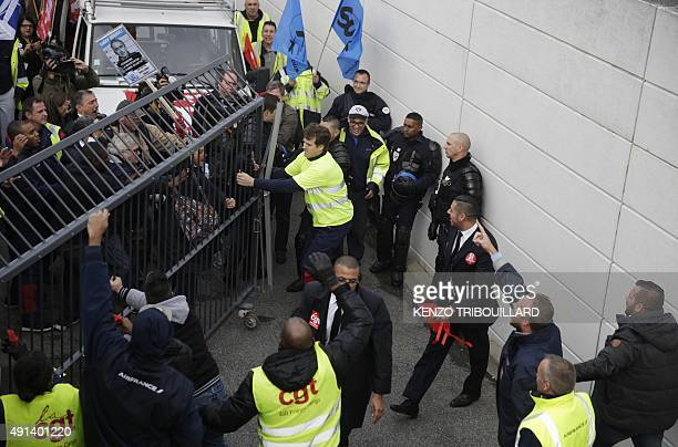 Demonstrators try to enter to Air France headquarters in RoissyenFrance on October 5 during a demonstration for the launch of a restructuring plan at...
