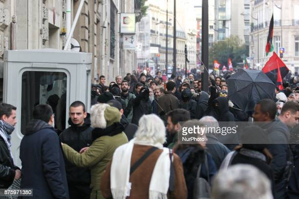 Demonstrators try to go down the flag of Saudi Arabia at the Saudi embassy in Paris during a march dubbed Marche sur l'Elysée called by the Social...