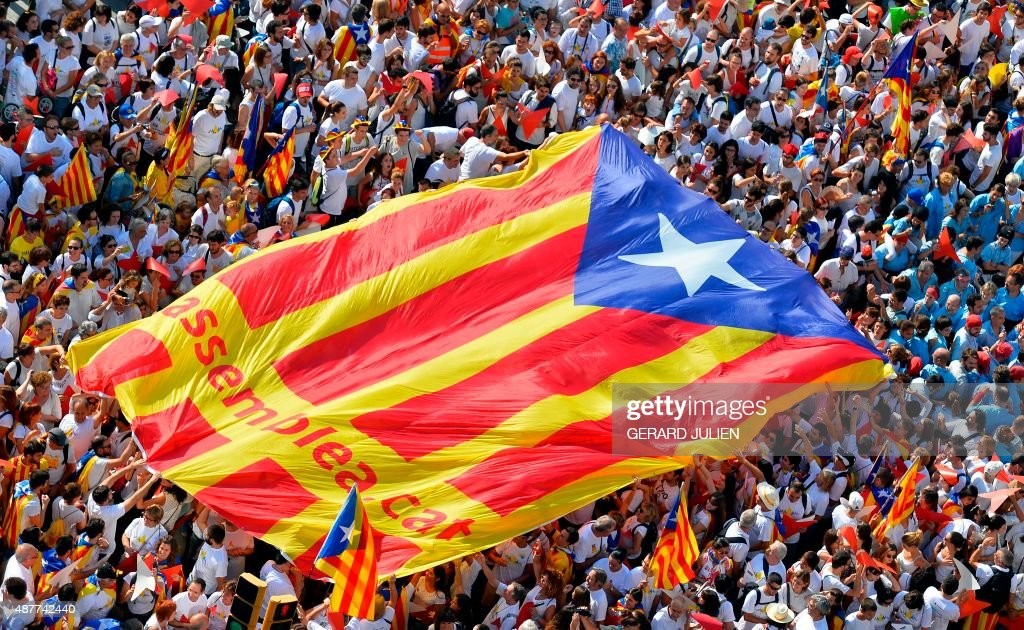 Demonstrators unfold a big 'estelada' during celebrations of Catalonia's National Day which recalls the final defeat of local troops by Spanish king...