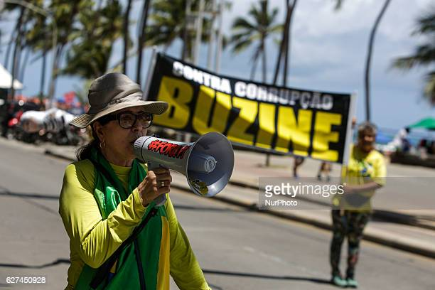 Demonstrators urge drivers to touch the horns of cars in protest of corruption Members of the popular Somos Mais Brasil movement protest against...